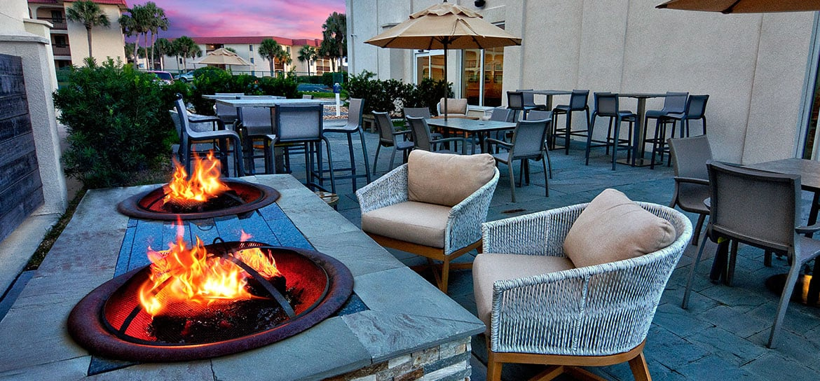 fire pits on outdoor patio with two cozy chairs