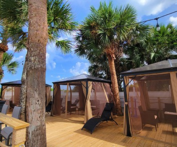 cabanas for rent by pool and tiki bar