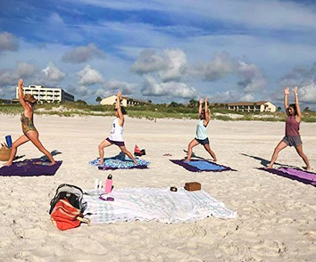 yoga on the beach in front of the hotel